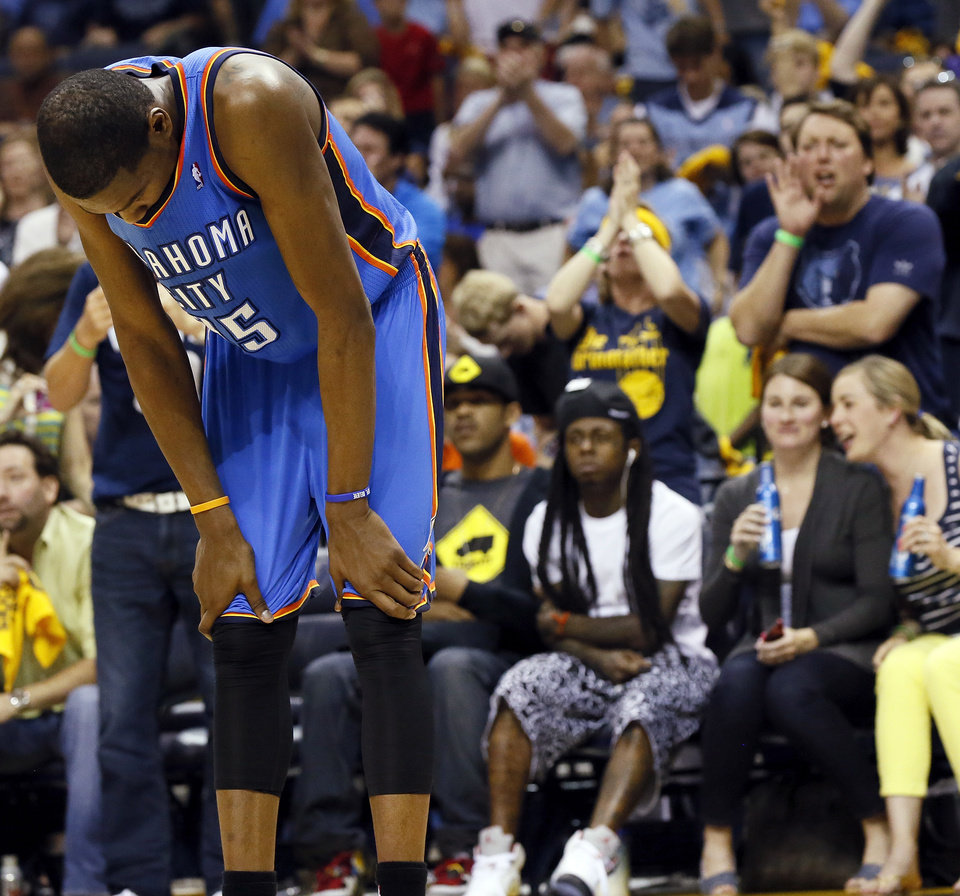 Photo - Oklahoma City's Kevin Durant (35) pauses after colliding with a teammate in the second half during Game 3 in the second round of the NBA basketball playoffs between the Oklahoma City Thunder and Memphis Grizzles at the FedExForum in Memphis, Tenn., Saturday, May 11, 2013. Memphis won, 87-81. Photo by Nate Billings, The Oklahoman