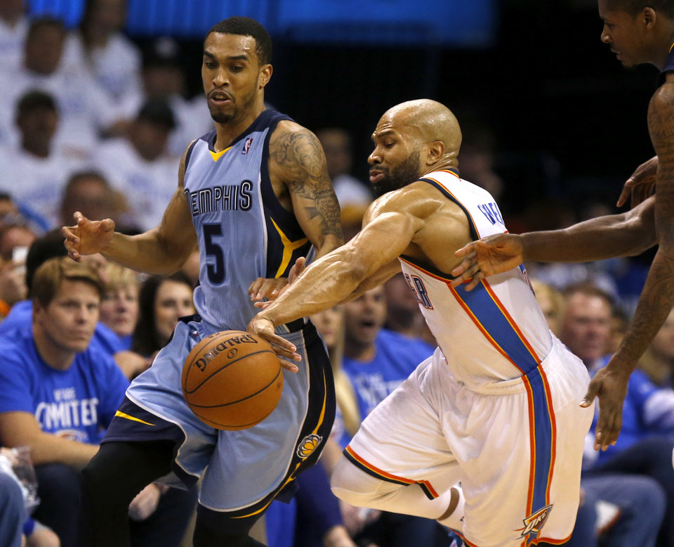 Photo - Oklahoma City's Derek Fisher (6) defends Memphis' Courtney Lee (5) during Game 2 in the first round of the NBA playoffs between the Oklahoma City Thunder and the Memphis Grizzlies at Chesapeake Energy Arena in Oklahoma City, Monday, April 21, 2014. Photo by Nate Billings, The Oklahoman