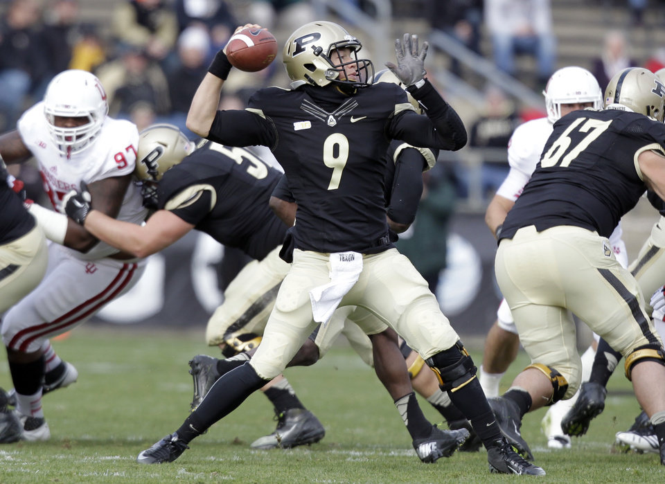 Photo - Purdue quarterback Robert Marve throws against Indiana during the first half of an NCAA college football game in West Lafayette, Ind., Saturday, Nov. 24, 2012. (AP Photo/Michael Conroy) ORG XMIT: INMC107