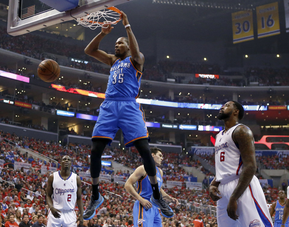 Photo - Oklahoma City's Kevin Durant (35) dunks in front of Los Angeles' DeAndre Jordan (6) during Game 3 of the Western Conference semifinals in the NBA playoffs between the Oklahoma City Thunder and the Los Angeles Clippers at the Staples Center in Los Angeles, Friday, May 9, 2014. Photo by Nate Billings, The Oklahoman