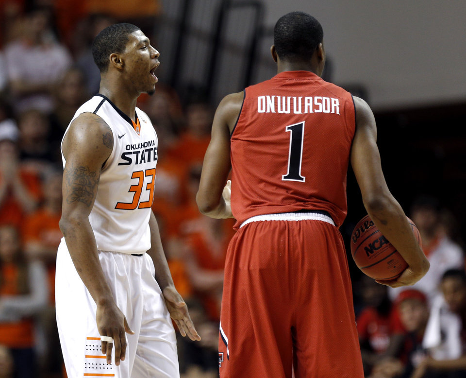 Photo - Oklahoma State's Marcus Smart (33) celebrates a Texas Tech turnover next to Randy Onwuasor (1) during the men's college basketball game between Oklahoma State and Texas Tech at Gallagher-Iba Arena in Stillwater, Okla., Saturday, Feb. 22, 2014. OSU won 84-62. 
