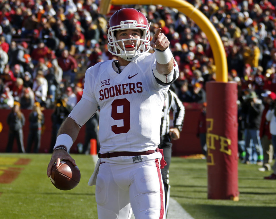 Photo -                    OU quarterback Trevor Knight celebrates after a touchdown during Saturday's 59-14 victory against Iowa State at Jack Trice Stadium in Ames, Iowa.                                                                             Photo by Bryan Terry, The Oklahoman