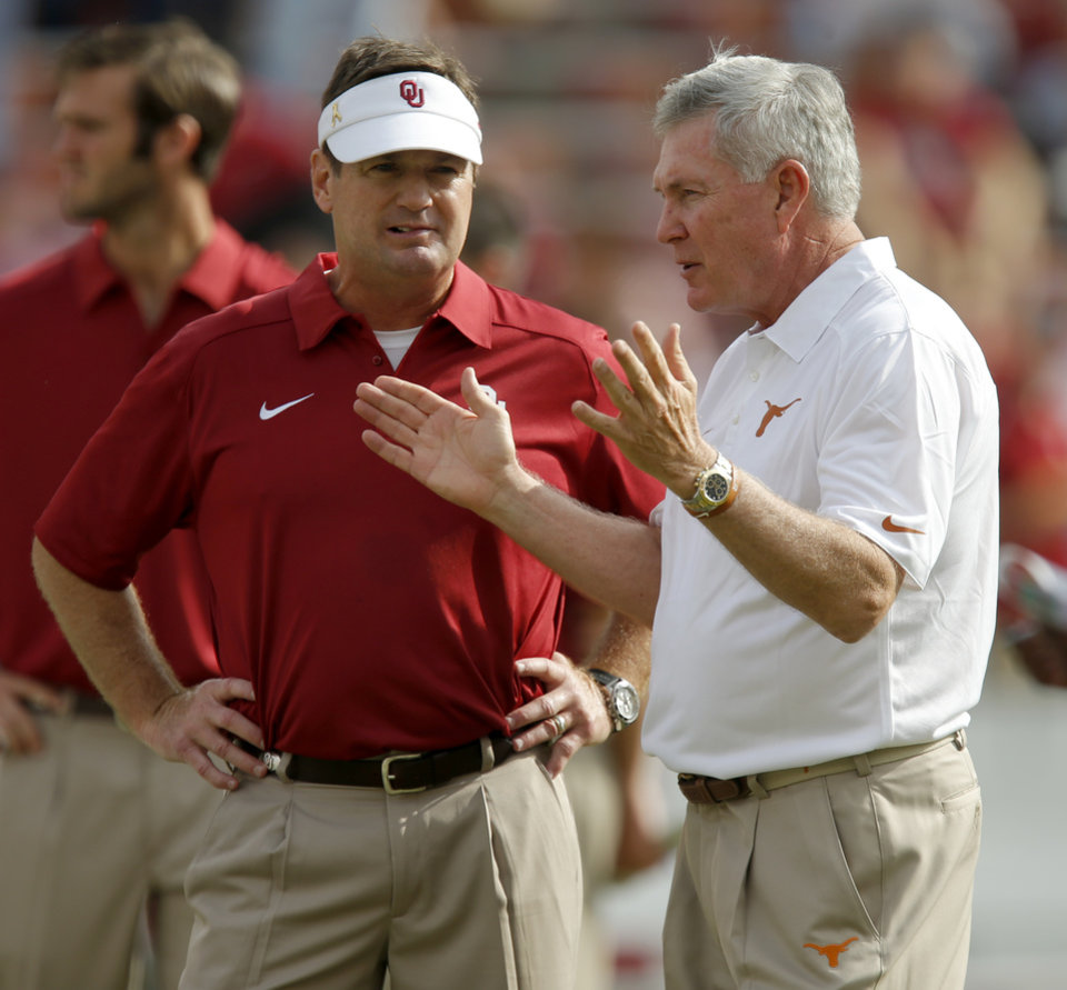 Oklahoma coach Bob Stoops talks with Texas coach Mack Brown before the Red River Rivalry college football game between the University of Oklahoma Sooners and the University of Texas Longhorns at the Cotton Bowl Stadium in Dallas, Saturday, Oct. 12, 2013. Photo by Bryan Terry, The Oklahoman
