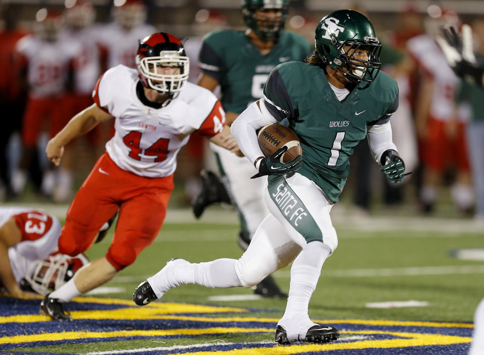 Edmond Santa Fe's Phillip Sumpter runs past Lawton's Taylor Wattenberger for a touchdown during their high school football game at Wantland Stadium in Edmond, Okla., Thursday, October 11, 2012. Photo by Bryan Terry, The Oklahoman