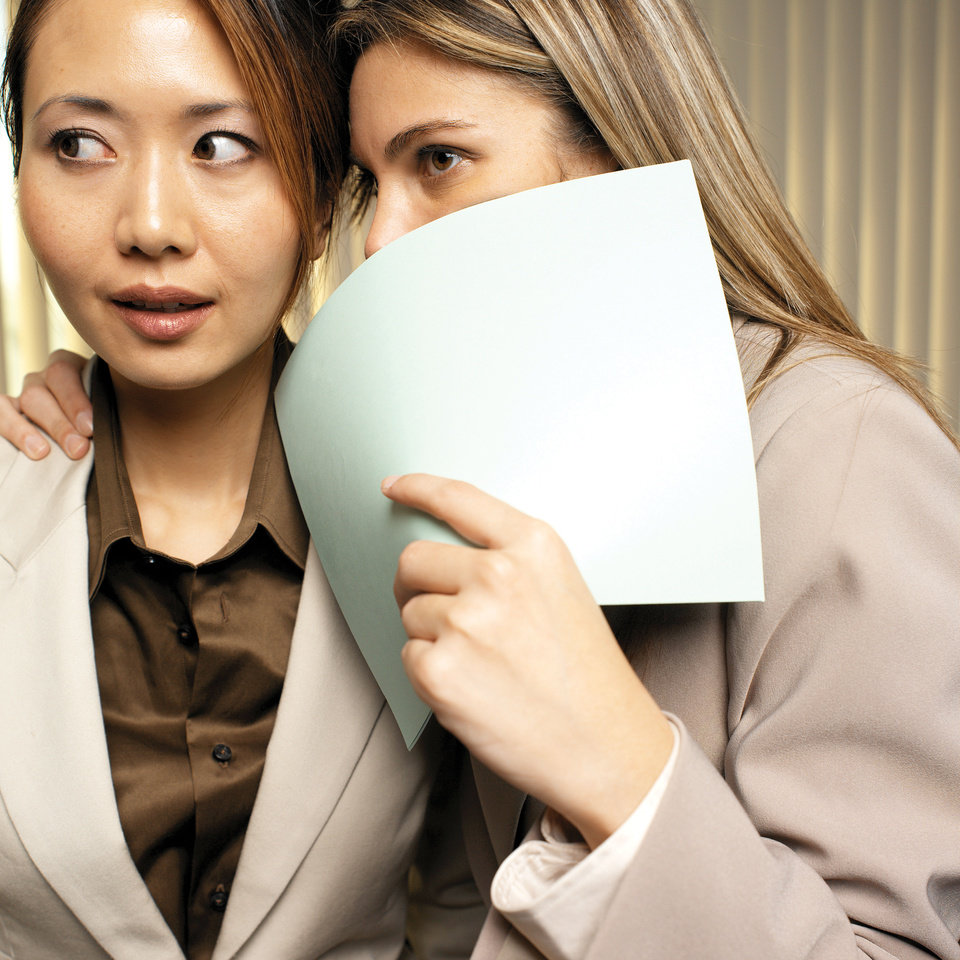 GOSSIP / PHOTO ILLUSTRATION / WOMEN / FEMALES: two businesswoman whispering in ear