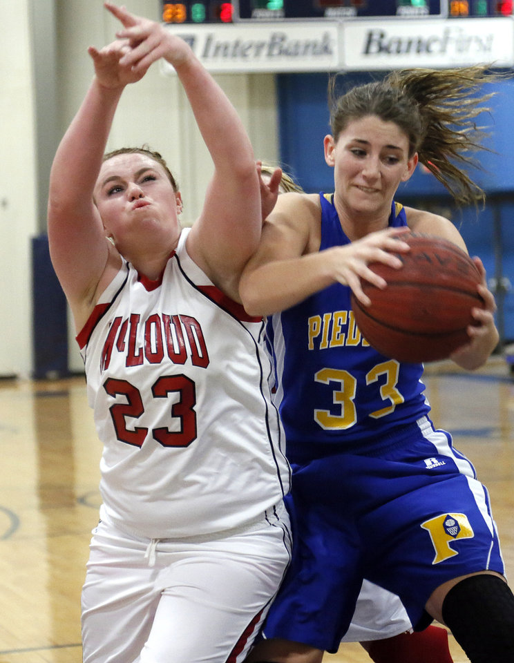 McLoud's Bethanie James (23) and Piedmont's Sarah Parker (33) battle for a rebound during a basketball tournament at the Kingfisher High School gym on Thursday, Jan. 24, 2013, in Kingfisher, Okla.  Photo by Chris Landsberger, The Oklahoman