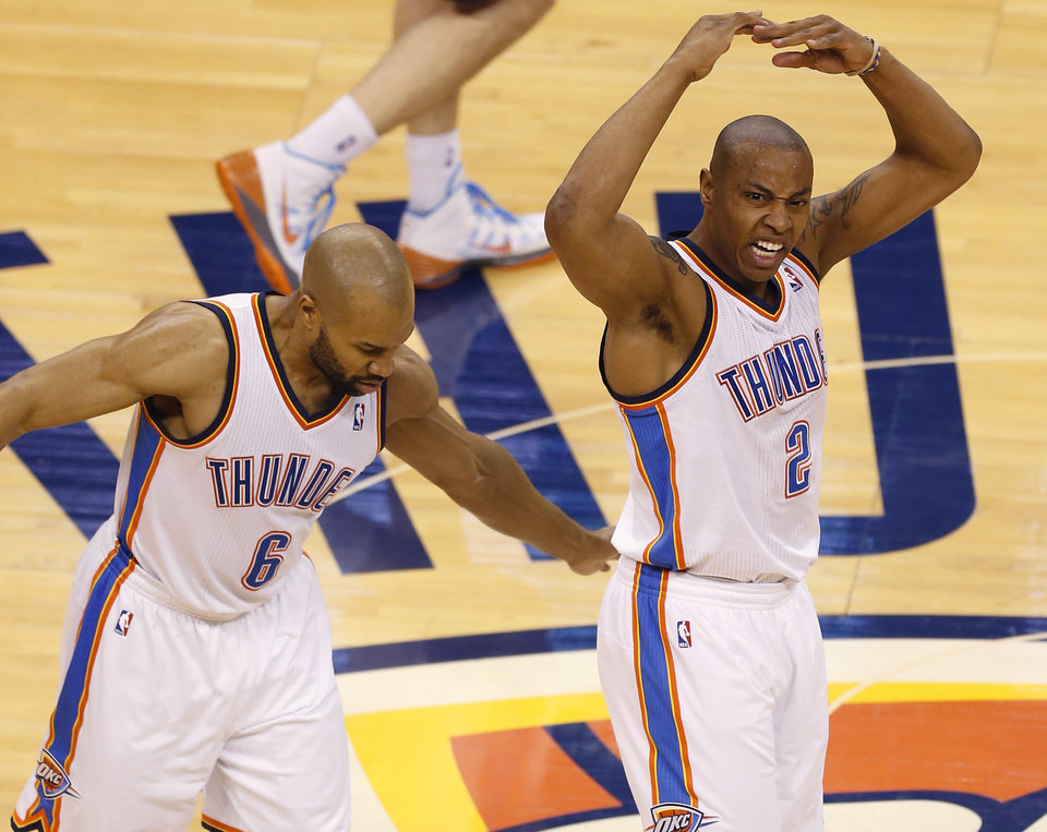 Photo - Oklahoma City's Caron Butler (2) and Derek Fisher (6) celebrate during Game 1 in the first round of the NBA playoffs between the Oklahoma City Thunder and the Memphis Grizzlies at Chesapeake Energy Arena in Oklahoma City, Saturday, April 19, 2014. Photo by Nate Billings, The Oklahoman