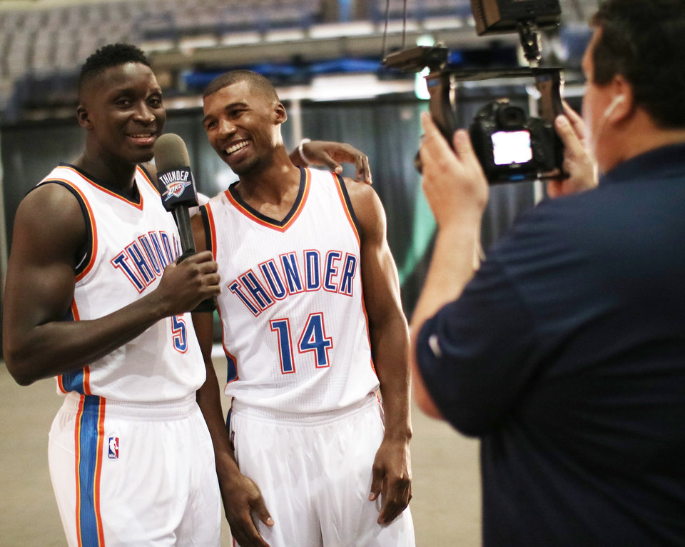 Photo - Victor Oladipo, left, interviews Ronnie Price during the Oklahoma City Thunder media day, Friday, September 23, 2016. Photo by Doug Hoke, The Oklahoman