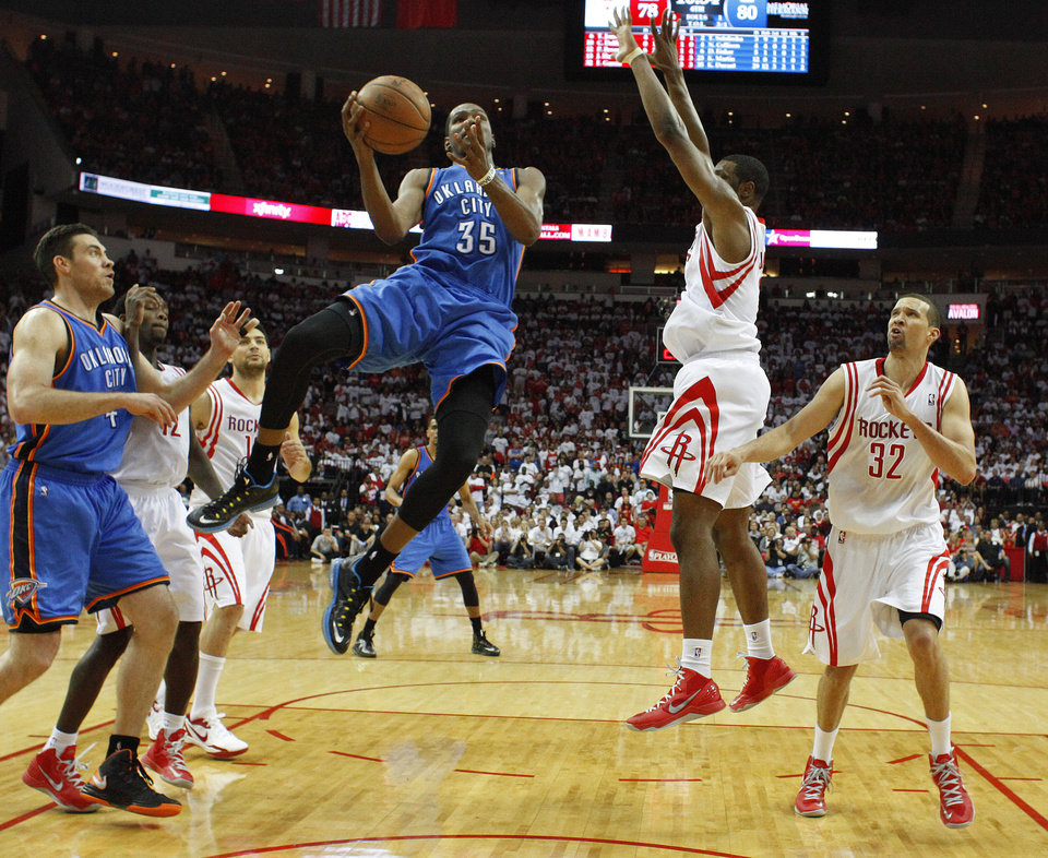 Photo - Oklahoma City's Kevin Durant (35) goes to the basket during Game 3 in the first round of the NBA playoffs between the Oklahoma City Thunder and the Houston Rockets at the Toyota Center in Houston, Texas, Sat., April 27, 2013. Oklahoma City won 104-101. Photo by Bryan Terry, The Oklahoman