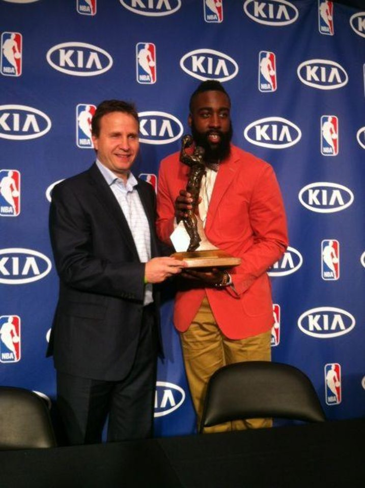 Photo - James Harden receiving the Sixth Man of the Year award with Oklahoma City Thunder coach Scott Brooks. May 10, 2012. Photo by Darnell Mayberry, The Oklahoman.