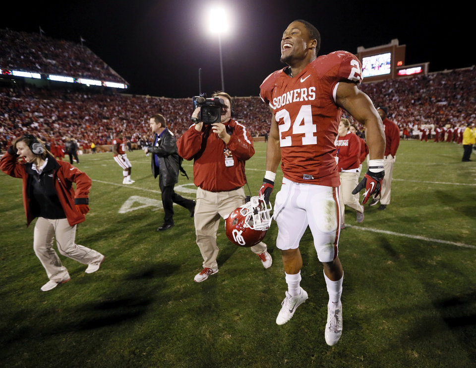 Oklahoma\'s Brennan Clay (24) celebrates after the Bedlam college football game between the University of Oklahoma Sooners (OU) and the Oklahoma State University Cowboys (OSU) at Gaylord Family-Oklahoma Memorial Stadium in Norman, Okla., Saturday, Nov. 24, 2012. OU won, 51-48 in overtime. Photo by Nate Billings , The Oklahoman