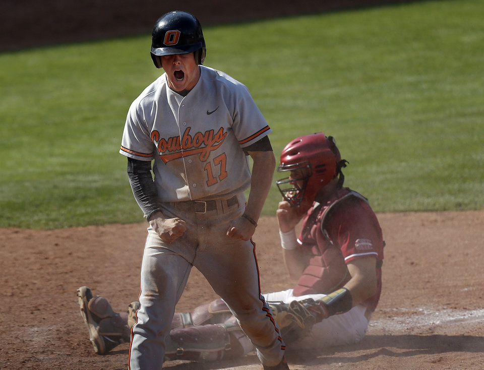 OU / OSU / COLLEGE BASEBALL / CELEBRATION: Oklahoma State's Gage Green celebrates stealing home in front of Oklahoma's  Anthony Hermely defends during the Bedlam baseball game between the University of Oklahoma and Oklahoma State University at the Chickasaw Bricktown Ballpark in Oklahoma CIty, Saturday, May 11, 2013. Photo by Sarah Phipps, The Oklahoman