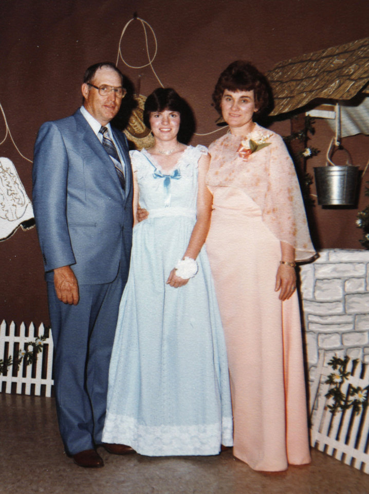 Photo - Mary Ann Temple-Lee, center, and her parents Raymond and Mary Temple, are pictured at Temple-Lee's senior prom at Elmore City High School in 1981.  COPY