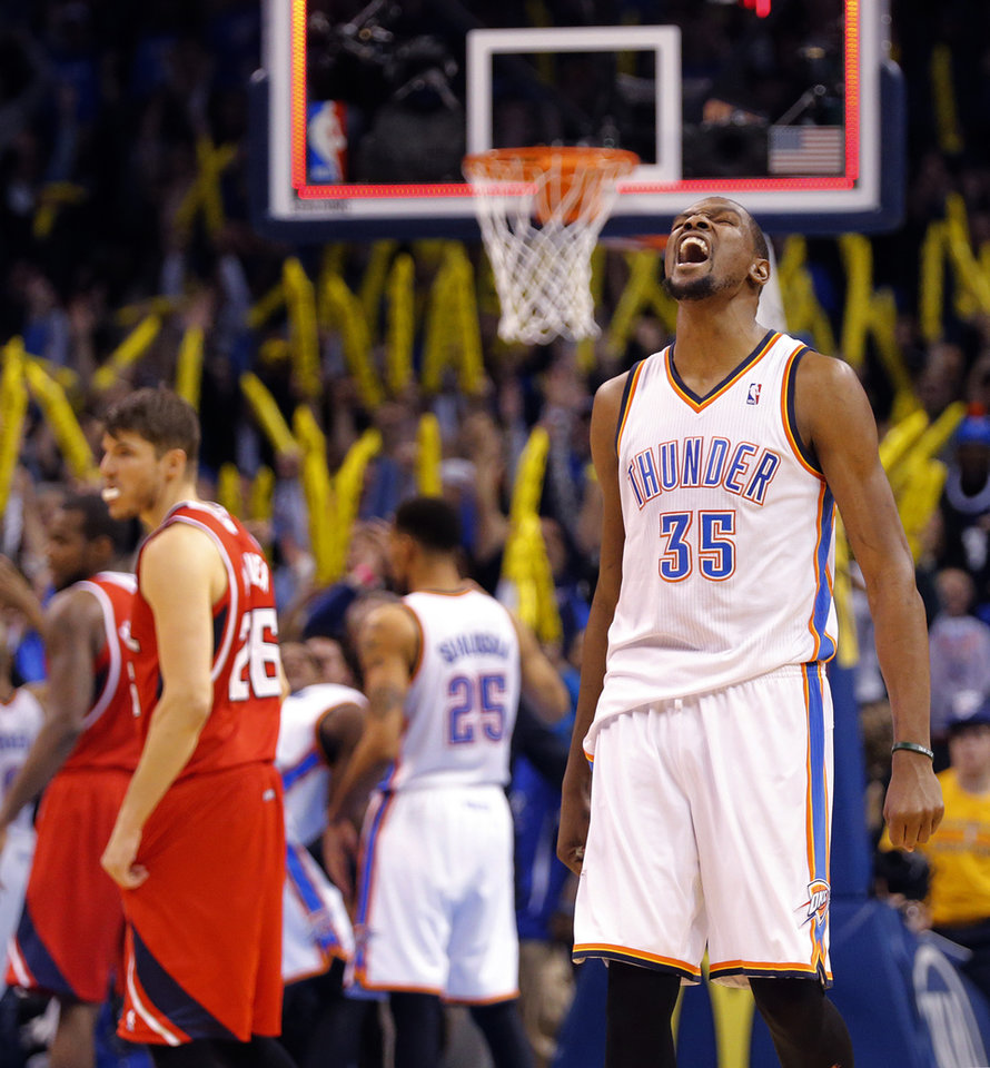 Photo - Oklahoma City's Kevin Durant (35) reacts after the 111-109 win over Atlanta during the NBA basketball game between the Oklahoma City Thunder and the Atlanta Hawks at the Chesapeake Energy Arena in Oklahoma City, Okla. on Monday, Jan. 27, 2014. Photo by Chris Landsberger, The Oklahoman