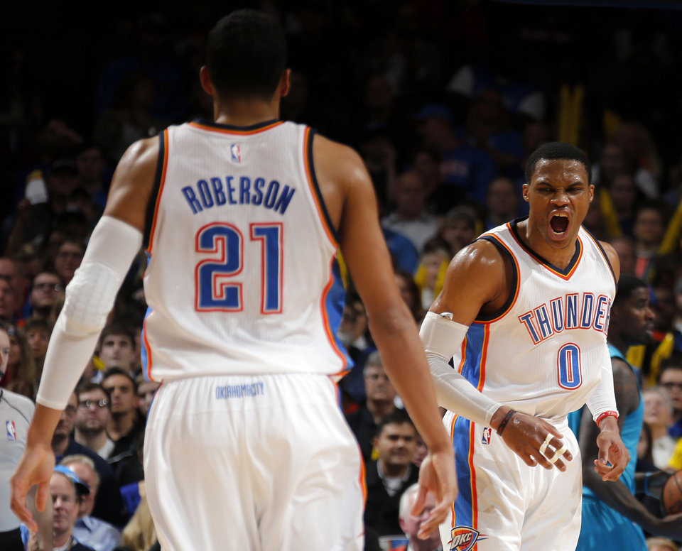 Photo - Oklahoma City's Russell Westbrook (0) and Andre Roberson (21) celebrateduring the NBA basketball game between the Oklahoma City Thunder and the Charlotte Hornets at the Chesapeake Energy Arena in Oklahoma City, Friday, Dec. 26, 2014. Photo by Sarah Phipps, The Oklahoman