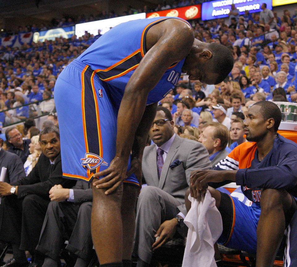 Photo - Oklahoma City's Kendrick Perkins (5) grimaces in pain during Game 4 of the first round in the NBA playoffs between the Oklahoma City Thunder and the Dallas Mavericks at American Airlines Center in Dallas, Saturday, May 5, 2012. Oklahoma City won 103-97.  Photo by Bryan Terry, The Oklahoman