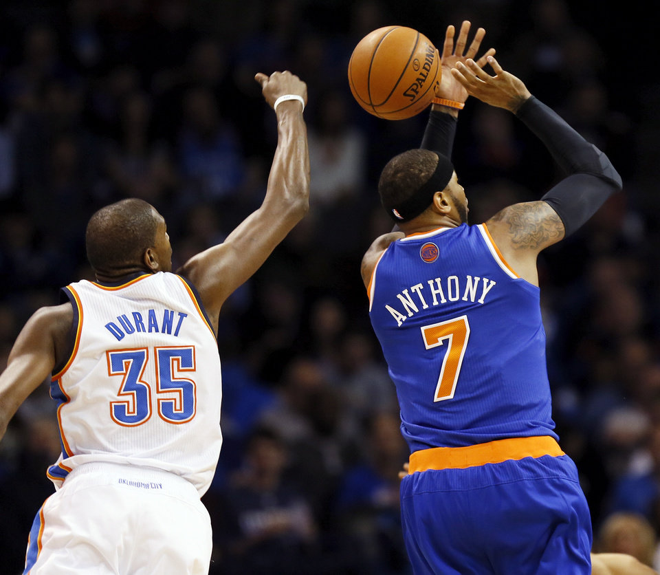 Oklahoma City\'s Kevin Durant (35) blocks the shot of New York\'s Carmelo Anthony (7) from behind during an NBA basketball game between the New York Knicks and the Oklahoma City Thunder at Chesapeake Energy Arena in Oklahoma City, Sunday, Feb. 9, 2014. Photo by Nate Billings, The Oklahoman