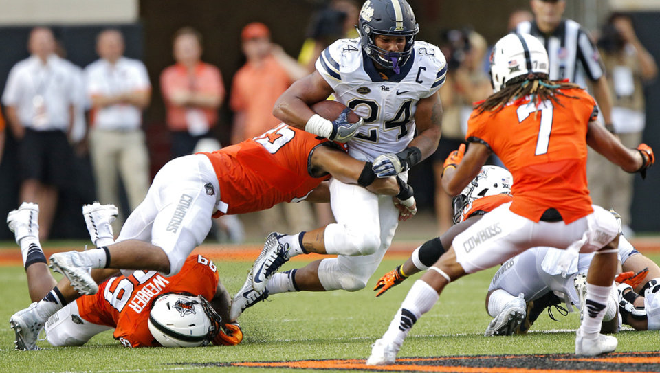 Photo - Oklahoma State's Tralund Webber (89), Chad Whitener (45) and Ramon Richards (7) trie to stop Pittsburgh's James Conner (24)  during a college football game between the Oklahoma State Cowboys (OSU) and the Pitt Panthers at Boone Pickens Stadium in Stillwater, Okla., Saturday, Sept. 17, 2016. Photo by Chris Landsberger, The Oklahoman