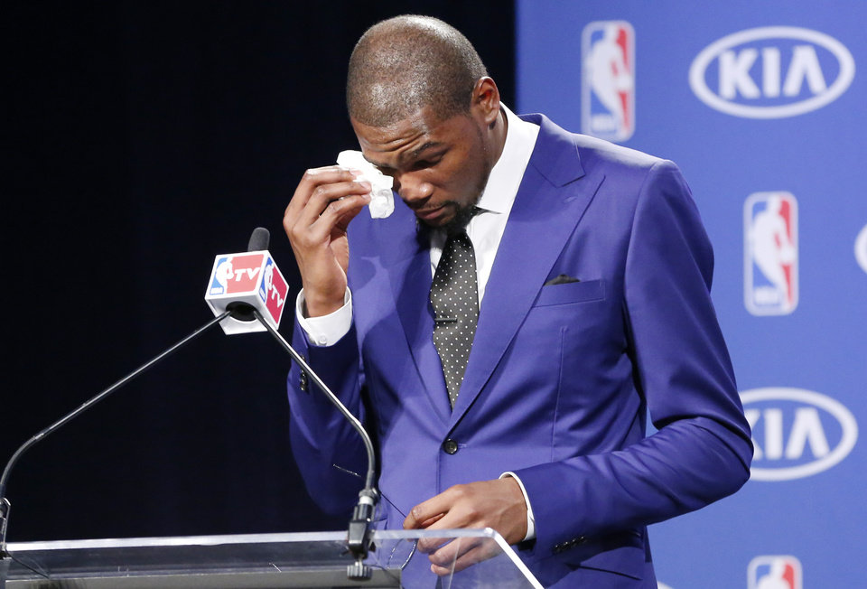 Oklahoma City Thunder\'s Kevin Durant wipes away tears as he speaks during a news conference to announce that Durant is the winner of the 2013-14 Kia NBA Basketball Most Value Player Award in Oklahoma City, Tuesday, May 6, 2014. (AP Photo/Sue Ogrocki)