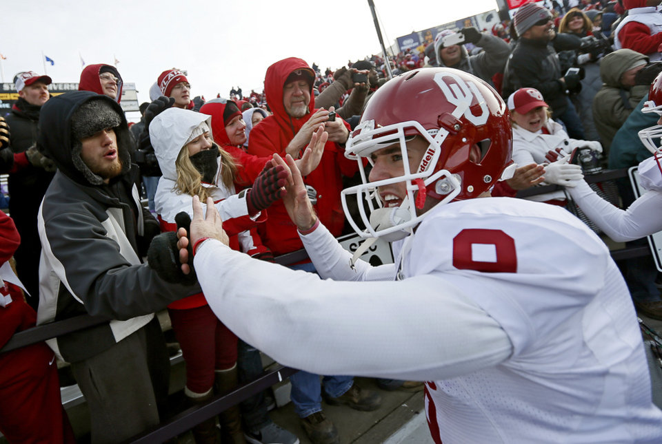 OU's Trevor Knight celebrates with fans after the Sooners' 41-31 over Kansas State.  Photo by Bryan Terry, The Oklahoman