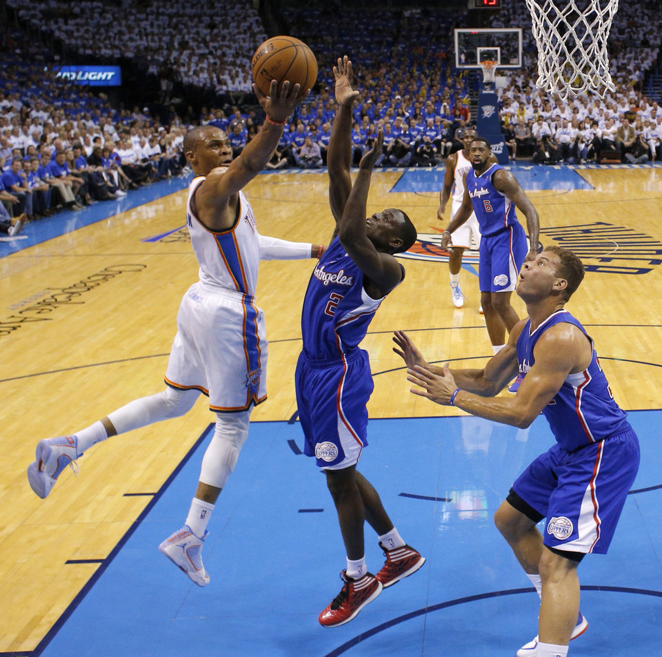 Photo - Oklahoma City's Russell Westbrook (0) goes to the basket beside Los Angeles' Darren Collison (2) and Blake Griffin (32) during Game 2 of the Western Conference semifinals in the NBA playoffs between the Oklahoma City Thunder and the Los Angeles Clippers at Chesapeake Energy Arena in Oklahoma City, Wednesday, May 7, 2014. Photo by Bryan Terry, The Oklahoman