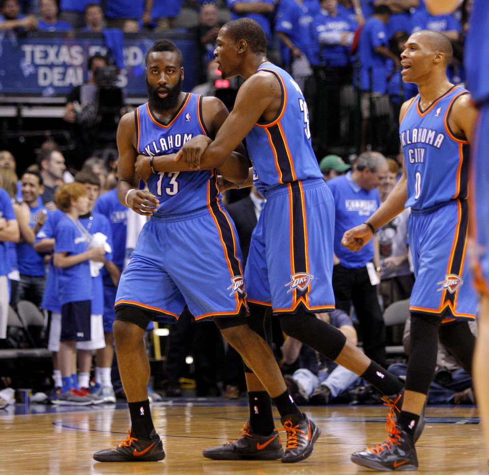 Oklahoma City's James Harden (13), Kevin Durant (35), and Russell Westbrook celebrate during Game 4 of the first round in the NBA playoffs between the Oklahoma City Thunder and the Dallas Mavericks at American Airlines Center in Dallas, Saturday, May 5, 2012. Oklahoma City won 103-97. Photo by Bryan Terry, The Oklahoman