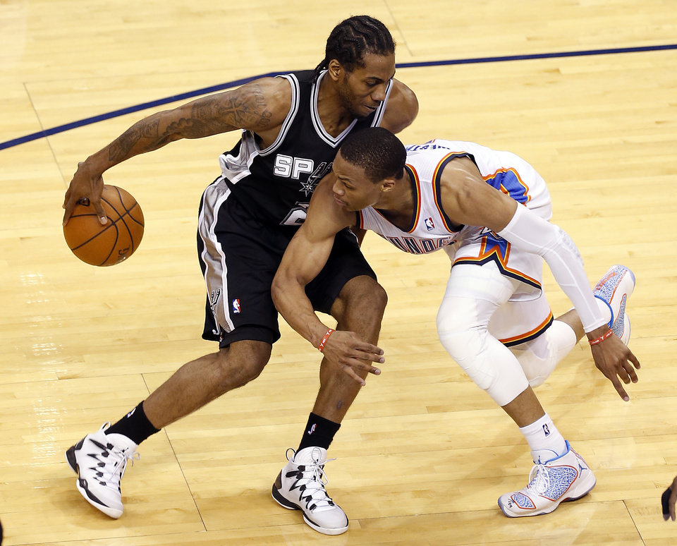 Photo - San Antonio's Kawhi Leonard (2) looks to get past Oklahoma City's Russell Westbrook (0) during Game 6 of the Western Conference Finals in the NBA playoffs between the Oklahoma City Thunder and the San Antonio Spurs at Chesapeake Energy Arena in Oklahoma City, Saturday, May 31, 2014. Photo by Nate Billings, The Oklahoman