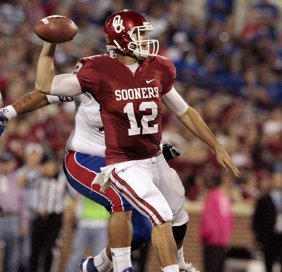 Photo - Landry Jones throws during the second half of the college football game where the University of Oklahoma Sooners (OU) defeated the University of Kansas Jayhawks (KU) 52-7 at Gaylord Family-Oklahoma Memorial Stadium in Norman, Okla., on Saturday, Oct. 20, 2012. Photo by Steve Sisney, The Oklahoman