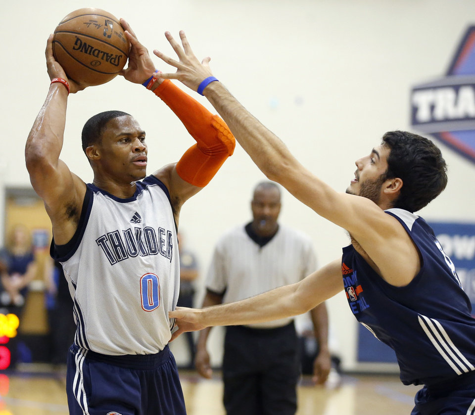 Photo - Oklahoma CIty's Russell Westbrook looks to pass over Alex Abrines during the Thunder's annual Blue and White Scrimmage at John Marshall Mid-High School in Oklahoma City, Tuesday, Sept. 27, 2016. Photo by Bryan Terry, The Oklahoman