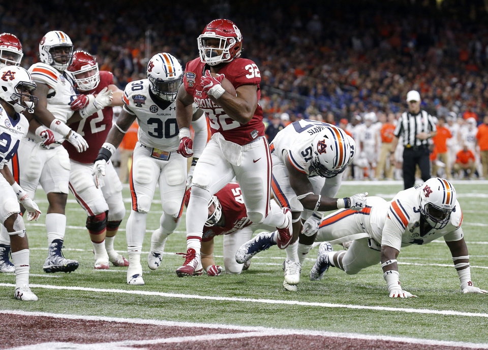 Photo - Oklahoma's Samaje Perine (32) scores a touchdown in the fourth quarter during the Allstate Sugar Bowl between University of Oklahoma Sooners (OU) and Auburn University Tigers at the Mercedes-Benz Superdome in New Orleans, Monday, Jan. 2, 2017.  Photo by Sarah Phipps, The Oklahoman