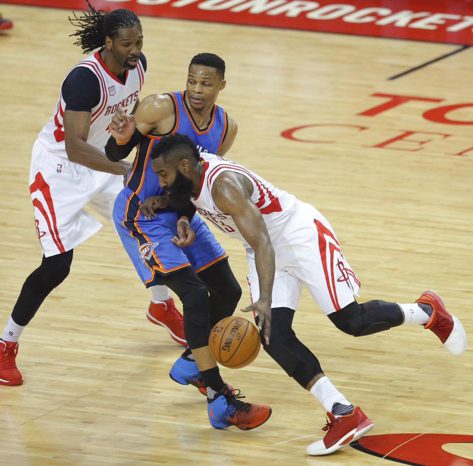 Photo - Oklahoma City's Russell Westbrook (0) defends as Houston's James Harden (13) goes past him in front of Nene (42) during Game 5 in the first round of the NBA playoffs between the Oklahoma City Thunder and the Houston Rockets at the Toyota Center in Houston, Texas,  Tuesday, April 25, 2017.  Photo by Sarah Phipps, The Oklahoman