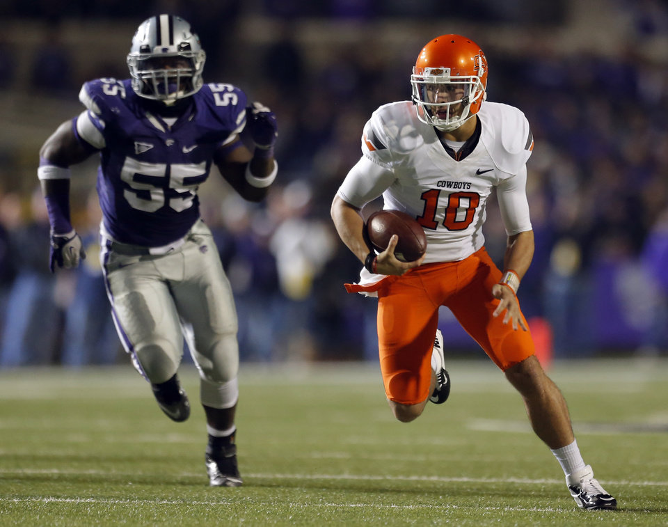Oklahoma State\'s Clint Chelf (10) scrambles as Kansas State\'s Adam Davis (55) chases him down during the college football game between Kansas State University (KSU) and Oklahoma State (OSU) at Bill Snyder Family Football Stadium in Manhattan, Kan., Saturday, Nov. 3, 2012. Photo by Sarah Phipps, The Oklahoman