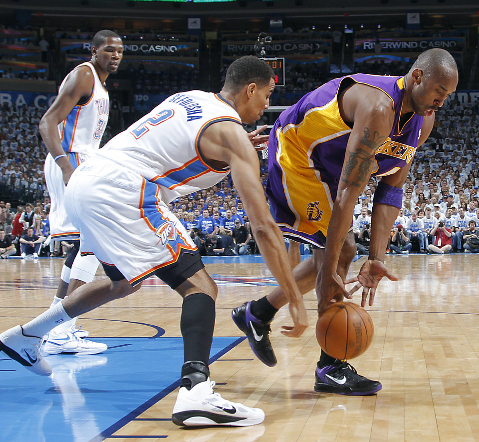 Oklahoma City's Thabo Sefolosha guards Los Angeles' Kobe Bryant during Game 2 in the second round of the NBA playoffs between the Oklahoma City Thunder and the L.A. Lakers at Chesapeake Energy Arena on Wednesday,  May 16, 2012, in Oklahoma City, Oklahoma. Photo by Chris Landsberger, The Oklahoman