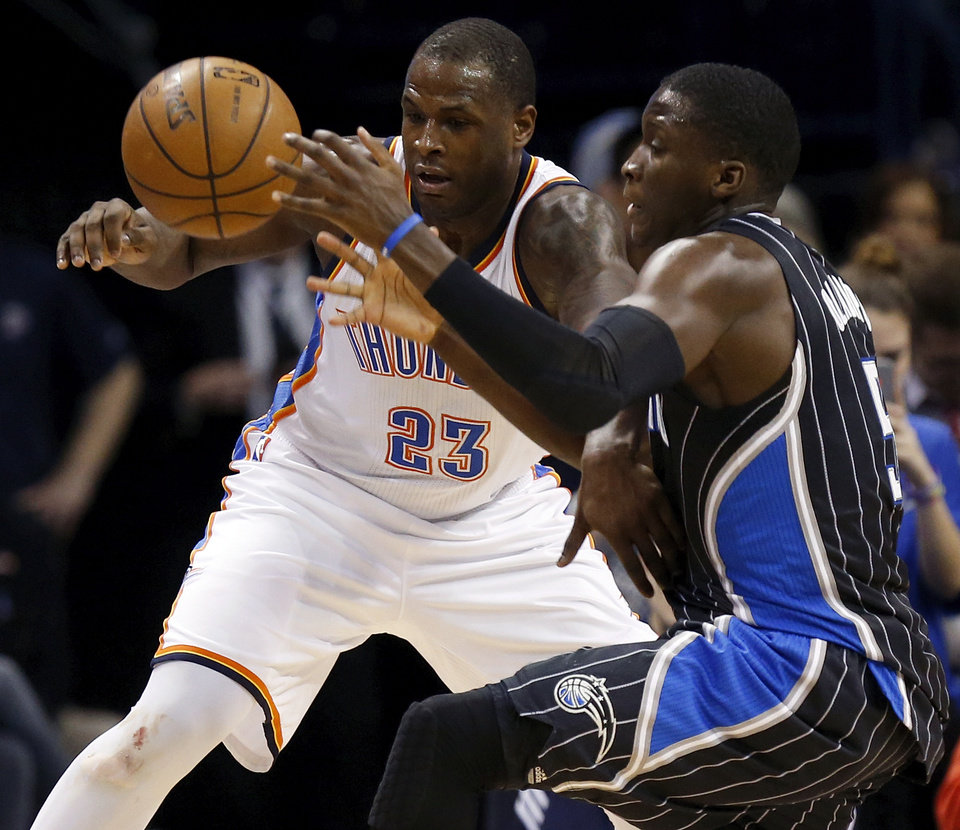 Photo - Orlando's Victor Oladipo (5) tries to take the ball from Oklahoma City's Dion Waiters (23) during an NBA basketball game between the Oklahoma City Thunder and the Orlando Magic at Chesapeake Energy Arena in Oklahoma City, Monday, Feb. 2, 2015. Oklahoma City won 104-97. Photo by Nate Billings, The Oklahoman