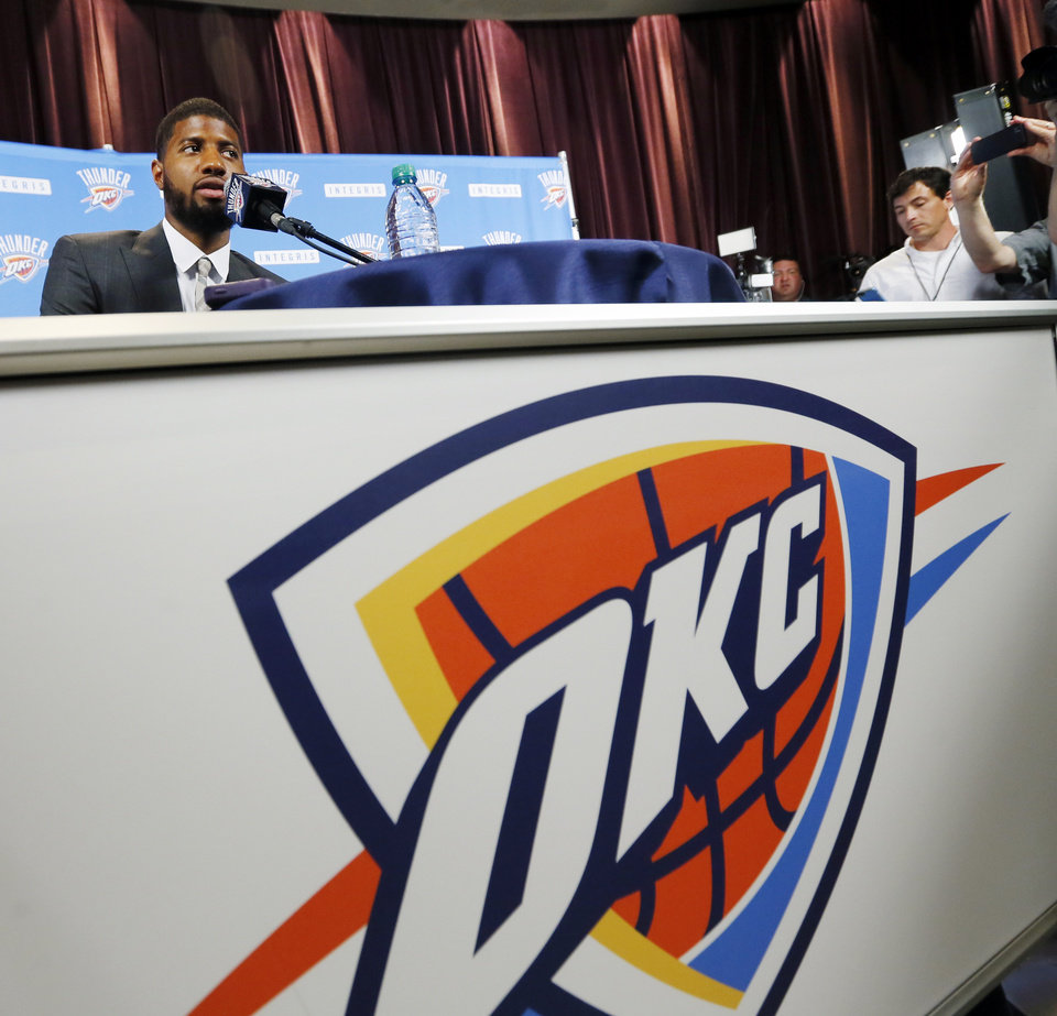 Photo - New Thunder player Paul George speaks to the media during an introductory press conference at the 21c Museum Hotel in Oklahoma City, Wednesday, July 12, 2017. Photo by Nate Billings, The Oklahoman