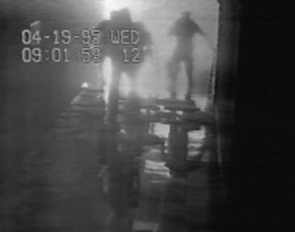 Photo -  This image is from a Southwestern Bell security camera that recorded people fleeing the communications company building in the seconds after the Oklahoma City bombing. The time on the first image is slightly behind the established time of the explosion — 9:02 a.m., April 19, 1995. The FBI provided videos from Southwestern Bell and other locations to Trentadue in 2009.