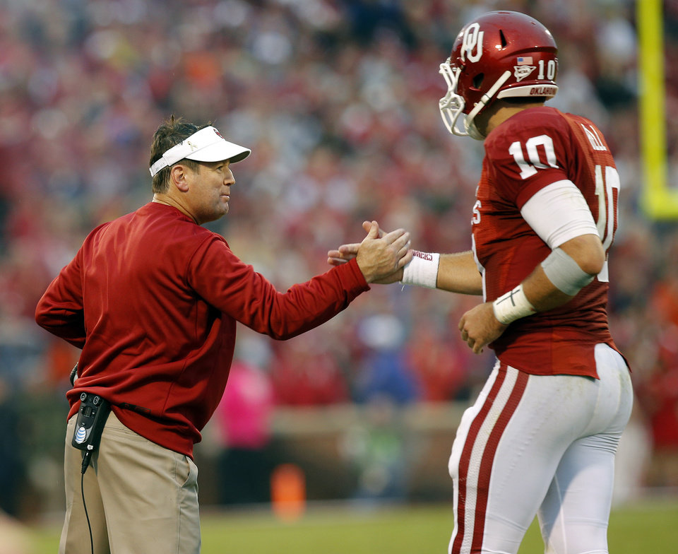 Oklahoma coach Bob Stoops elaborates with Blake Bell (10) after a touchdown pass during a college football game between the University of Oklahoma Sooners (OU) and the Texas Tech Red Raiders at Gaylord Family-Oklahoma Memorial Stadium in Norman, Okla., on Saturday, Oct. 26, 2013. Oklahoma won 38-30. Photo by Bryan Terry, The Oklahoman