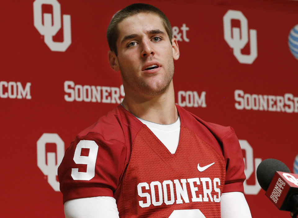 Oklahoma quarterback Trevor Knight answers a question during a news conference in Norman, Okla., Saturday, Aug. 3, 2013. (AP Photo/Sue Ogrocki) ORG XMIT: OKSO110