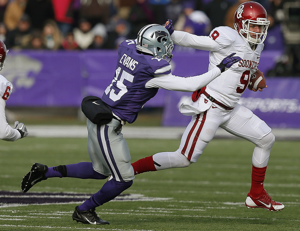 Oklahoma's Trevor Knight (9) runs past  State's Randall Evans (15) during an NCAA college football game between the Oklahoma Sooners and the Kansas State University Wildcats at Bill Snyder Family Stadium in Manhattan, Kan., Saturday, Nov. 23, 2013. Oklahoma won 41-31. Photo by Bryan Terry, The Oklahoman