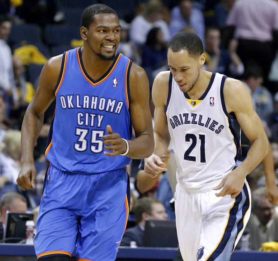 Photo - Oklahoma City's Kevin Durant (35) smiles in front of Memphis' Tayshaun Prince (21) after a basket during Game 6 in the first round of the NBA playoffs between the Oklahoma City Thunder and the Memphis Grizzlies at FedExForum in Memphis, Tenn., Thursday, May 1, 2014. Oklahoma City won 104-84. Photo by Bryan Terry, The Oklahoman