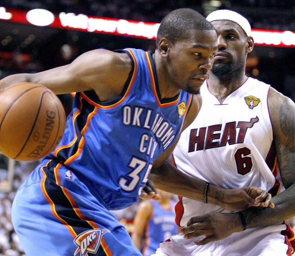 Oklahoma City\'s Kevin Durant (35) tries to get past Miami\'s LeBron James (6) during Game 5 of the NBA Finals between the Oklahoma City Thunder and the Miami Heat at American Airlines Arena, Thursday, June 21, 2012. Photo by Bryan Terry, The Oklahoman
