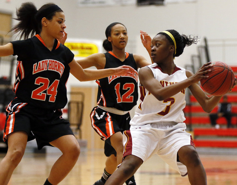 Photo - Nakylia Carter (3) of Putnam City North looks to pass away from Kaylan Mayberry (12) and MiKayla Alexander (24) of Booker T. Washington during the championship game of the Lady Jag Classic girls basketball tournament between Booker T. Washington and Putnam City North at Westmoore High School in Oklahoma City, Saturday, Jan. 12, 2013. Photo by Nate Billings, The Oklahoman