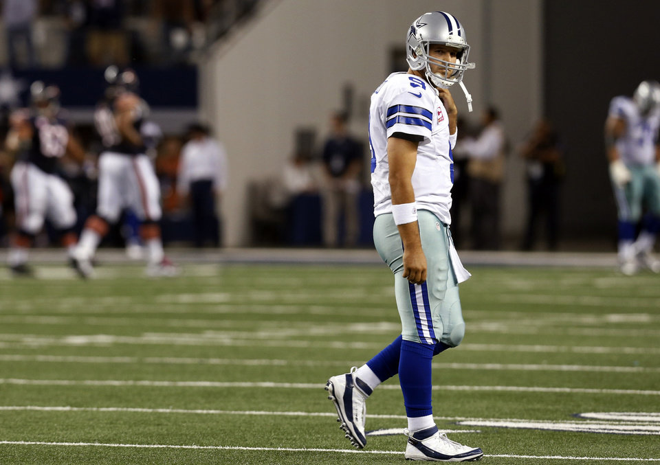 Dallas Cowboys quarterback Tony Romo (9) leaves the field after throwing an interception to Chicago Bears outside linebacker Lance Briggs during the second half of an NFL football game, Monday, Oct. 1, 2012, in Arlington, Texas. The Bears won 34-18. (AP Photo/Sharon Ellman) ORG XMIT: CBS141
