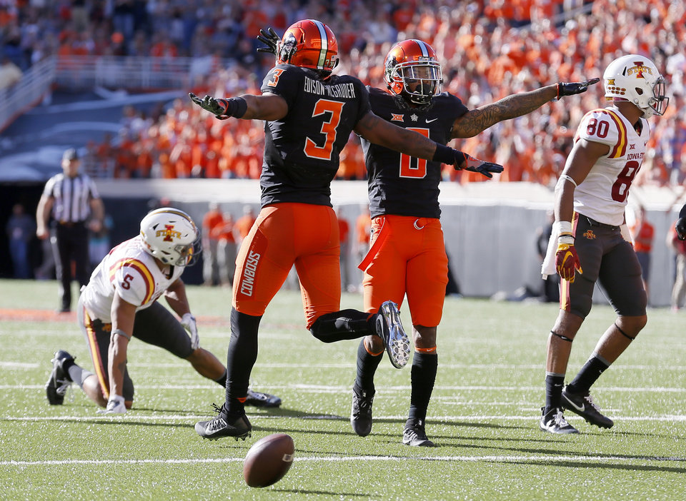 Photo - Oklahoma State's Ashton Lampkin (6) and Kenneth Edison-McGruder (3) celebrate a defensive stop in front of Iowa State's Allen Lazard (5) and Carson Epps (80) during a college football game between the Oklahoma State University Cowboys (OSU) and the Iowa State University at Boone Pickens Stadium in Stillwater, Okla., Saturday, Oct. 8, 2016. Photo by Sarah Phipps, The Oklahoman