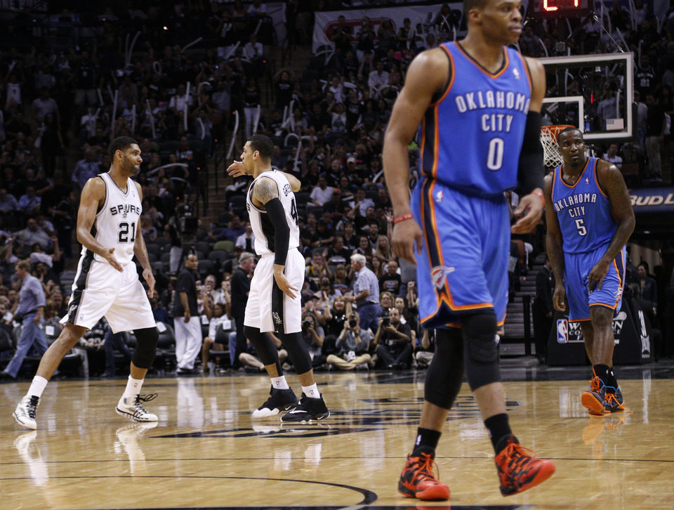 San Antonio's Tim Duncan (21) and Danny Green (4) celebrate as Oklahoma City's Russell Westbrook (0) and Kendrick Perkins (5) walks off the court for a time out  during Game 2 of the Western Conference Finals in the NBA playoffs between the Oklahoma City Thunder and the San Antonio Spurs at the AT&T Center in San Antonio, Wednesday, May 21, 2014. Photo by Sarah Phipps