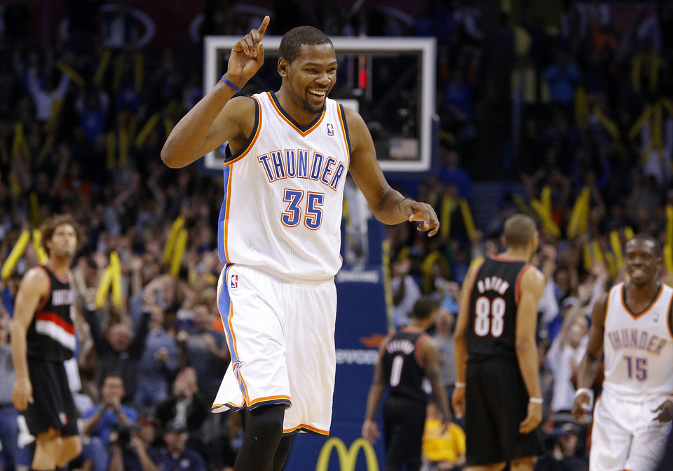 Oklahoma City's Kevin Durant (35) celebrates after a three-point basket late in the fourth quarter of an NBA basketball game between the Oklahoma City Thunder and the Portland Trail Blazers at Chesapeake Energy Arena in Oklahoma City, Tuesday, Jan. 21, 2014. Oklahoma City won 105-97. Photo by Bryan Terry, The Oklahoman
