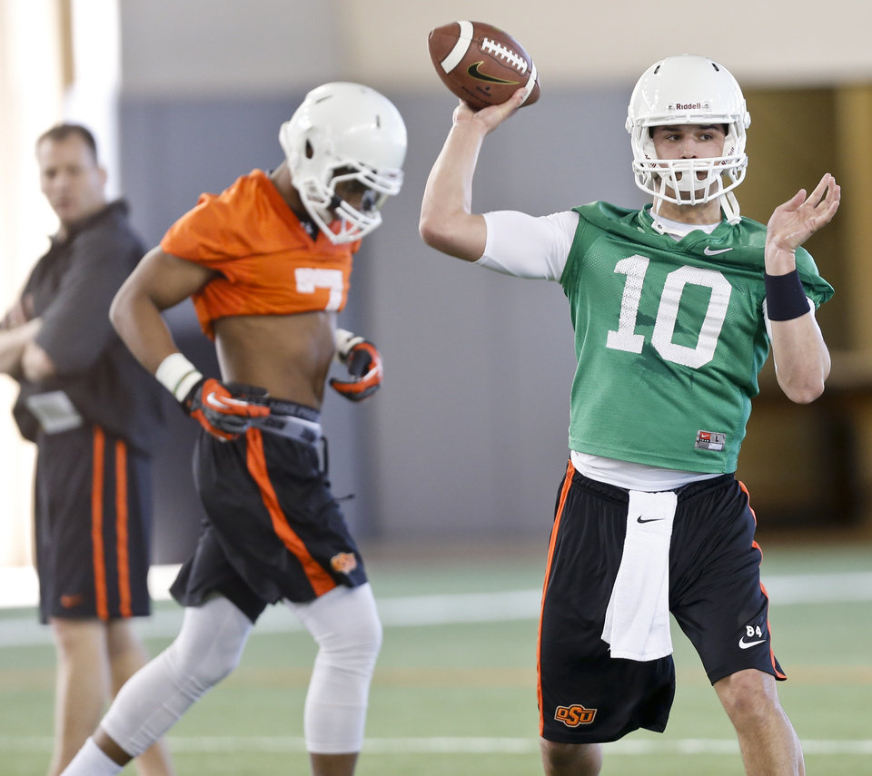 Photo - Quarterback Mason Rudolph (10) throws a pass during the first day of spring football practice at Oklahoma State University in Stillwater, Okla., on Monday, March 10, 2014.  Photo by Chris Landsberger, The Oklahoman
