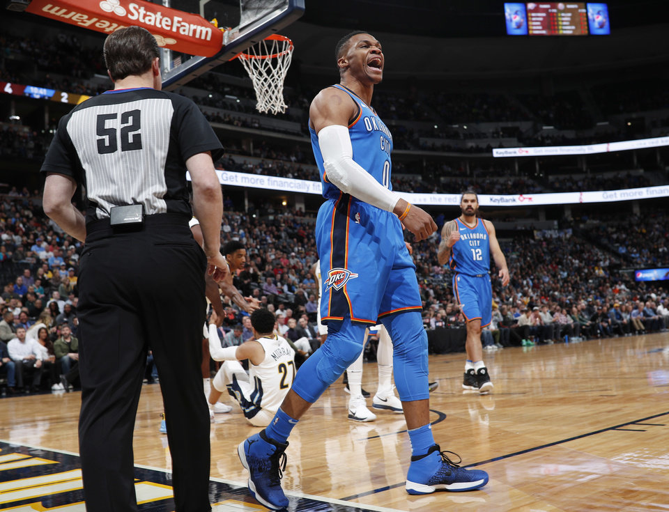 Photo -  Oklahoma City Thunder guard Russell Westbrook yells to the bench after driving the lane for a basket Thursday against the Denver Nuggets. The Nuggets won, 102-94. [AP Photo]