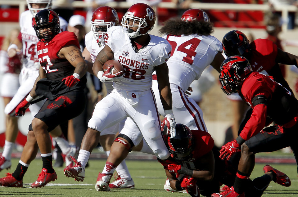 Photo - Oklahoma's Samaje Perine (32) runs past Austin Stewart (8) during a college football game between the University of Oklahoma Sooners (OU) and the Texas Tech Red Raiders at Jones AT&T Stadium in Lubbock, Texas, Saturday, November 15, 2014.  Photo by Bryan Terry, The Oklahoman