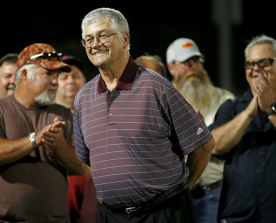 Photo - Former Cashion coach Larry Mantle is honored during halftime of Cashion's high school football game against Minco in Cashion, Okla., Friday, Sept. 27, 2013. Photo by Bryan Terry, The Oklahoman